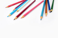 Color pencils isolated on white background. In a beautiful way Royalty Free Stock Photo