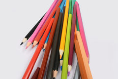 Color pencils isolated on white background. In a beautiful way Royalty Free Stock Photography