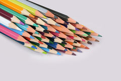 Color pencils isolated on white background. In a beautiful way Royalty Free Stock Image