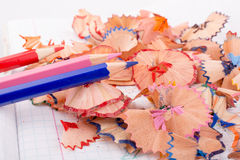 Color pencils with its shavings. On white background Royalty Free Stock Photo