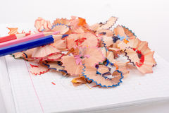 Color pencils with its shavings. On white background Stock Photo