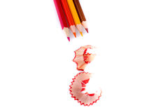 Color pencils with its shavings. On white background Royalty Free Stock Images