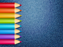Color pencils on jeans Royalty Free Stock Photo