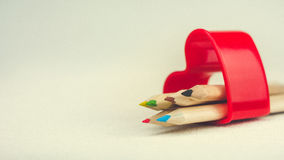 Color pencils laying in red heart symbol and represent love to creativity drawing.  royalty free stock image