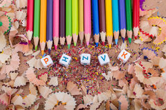 Color Pencils  and letter cubes on pencil shavings. Color Pencils  and letter cubes on the pencil shavings Royalty Free Stock Photography