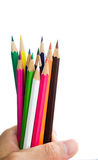 Color pencils macro. A set of colored pencils in hand royalty free stock photo