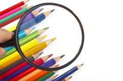 Color pencils, magnifier Stock Photography