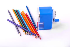 Color pencils and mechanical sharpener Royalty Free Stock Images