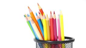 Color pencils in metal basket isolated white background stock footage