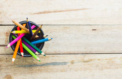 Color pencils in metallic modern basket Royalty Free Stock Images