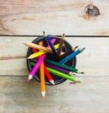 Color pencils in metallic modern basket Royalty Free Stock Photos