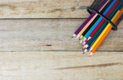 Color pencils in metallic modern basket Royalty Free Stock Photo