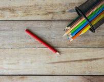 Color pencils in metallic modern basket Stock Photo