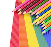 Color pencils on multi-colored paper Royalty Free Stock Image