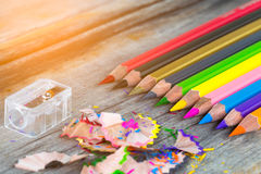 Color pencils. Multi color pencils and particle on wooden table, selective focus Royalty Free Stock Image