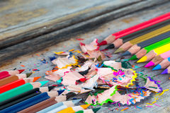 Color pencils. Multi color pencils and particle on wooden table, selective focus Stock Images