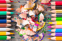 Color pencils. Multi color pencils and particle on wooden table, selective focus Royalty Free Stock Photos