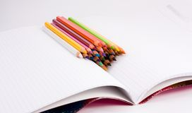 Color pencils on notebook Stock Image