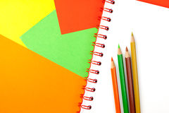 Color pencils and notebook Royalty Free Stock Photography