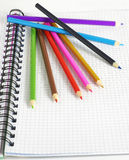 Color pencils & notepad Royalty Free Stock Image