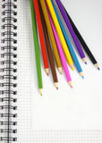 Color pencils and notepad Royalty Free Stock Photos