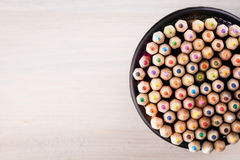 Color pencils in a office bin on wooden background Stock Photography