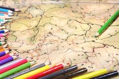 Color pencils on old map. Color pencils on old contoured map, shallow DOF Stock Photo