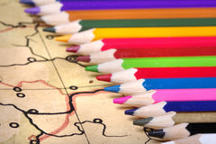Color pencils on old map Royalty Free Stock Photo