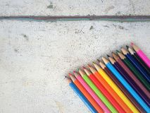 Color pencils on old wood background. Royalty Free Stock Images