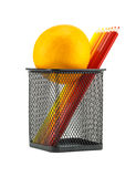 Color pencils and orange in pencil holders Royalty Free Stock Photo
