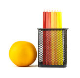 Color pencils and orange in pencil holders Royalty Free Stock Images