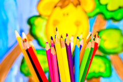 Color pencils over child painting Royalty Free Stock Photos
