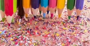 Color Pencils over a notebook. With pencil shavings Royalty Free Stock Photography