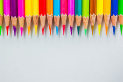 Color pencils  over white background close up Royalty Free Stock Photos