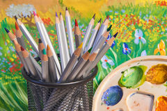 Color pencils and paint palette Stock Photos