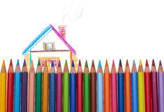 Color pencils. Painted house behind the color pencil fence Stock Photography