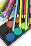 Color pencils and paints Royalty Free Stock Image