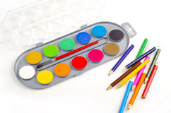 Color pencils and paints Stock Images