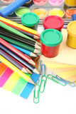 Color pencils and paints Royalty Free Stock Photos