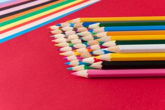 Color pencils. And color paper Royalty Free Stock Photography