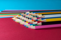 Color pencils. And color paper royalty free stock photos