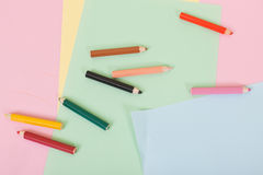 Color pencils and paper on children desk Stock Image