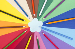 Color pencils on paper with flower memo note. Royalty Free Stock Photography
