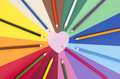 Color pencils on paper with pink heart memo note. Royalty Free Stock Images