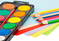 Color pencils, papers and paints Stock Photo