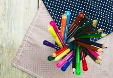 Color pencils and pen on wooden table see on top view. Royalty Free Stock Photography