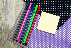 Color pencils and pen on wooden table see on top view. Stock Image