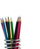 Color pencils in a pencil holder. One of the oldest and most widely used writing utensils Stock Photography