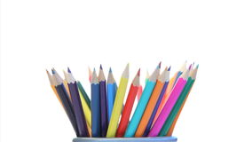 Color pencils in a pencil holder turning stock video footage