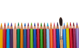 Color pencils. Color pencil row and one paintbrush Royalty Free Stock Images